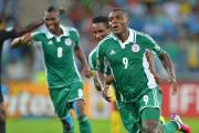 Nigeria's Emmanuel Emenike, 9, celebrates one of the goals which have made him the tournament's top scorer.