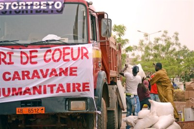 Food aid is loaded onto trucks in Bamako: Humanitarian access is improving in Mali but the situation remains volatile.