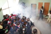 (File photo) Zambian police beat and teargas opposition protesters.