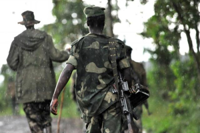 Rebels (file photo): Three people have been killed at the DR Congo-Uganda border, according to security sources.
