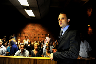 Paralympian Oscar Pistorius enters the dock at the Pretoria Magistrate's Court.