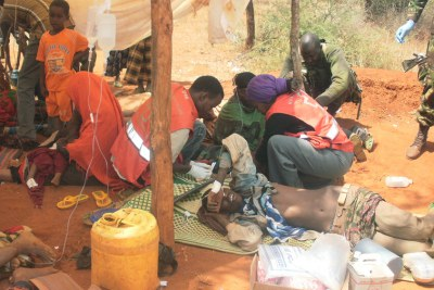 Kenya Red Cross Society personnel assist people injured in retaliatory attacks in Mandera county (file photo).
