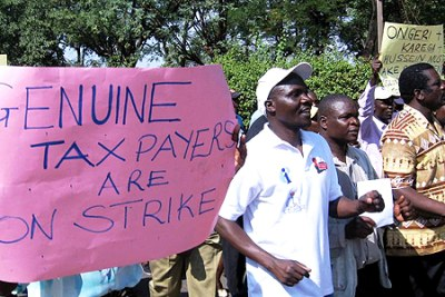 Teachers defy court order and vow to continue with strike over unpaid dues by the government (file photo).