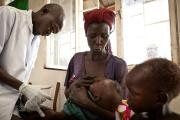 A mother gives her daughter a dose of paracetemol to offset the symptoms of malaria in Northern Bahr el Ghazal State, South Sudan.