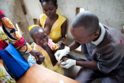A young child is given a malaria rapid test at a hospital in Bossangoa, Central African Republic.