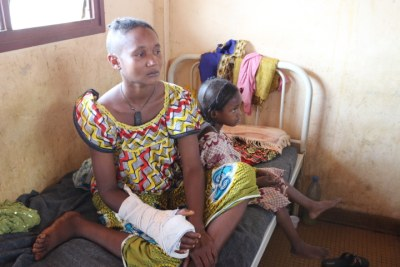 Peul woman and her daughter in Bangui's Hopital Communautaire. Both suffered machete attacks to the head when their village.