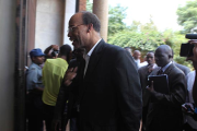 Charged: Mel Reynolds arriving for the court hearing in Harare.