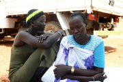 Two women sit at the UNMISS base in Rumbek, Lakes State, South Sudan.