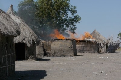 A home burns in Malakal, South Sudan
