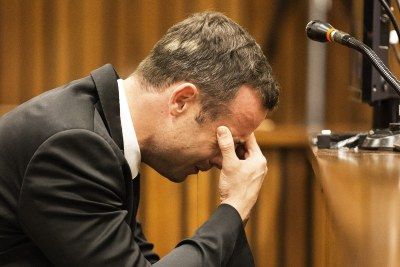 South African Paralympic athlete Oscar Pistorius cries in court (file photo).