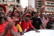 MDC-T supporters gather outside Harvest house in support of Morgan Tsvangirai.