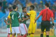 Alexander Song apologises for a foul in Cameroon's clash with Mexico.