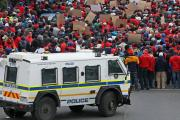 Members of the National Union of Metalworkers of South Africa march for better wages in Cape Town.