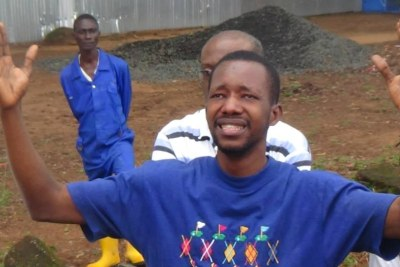 An Ebola survivor rejoices upon being released from an isolation center.