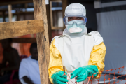 A nurse enters the high-risk Ebola area after getting dressed with protective clothing (file photo).