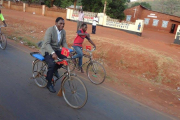 Opposition candidate Hakainde Hichilema cycles along a street in Zambia (file photo).