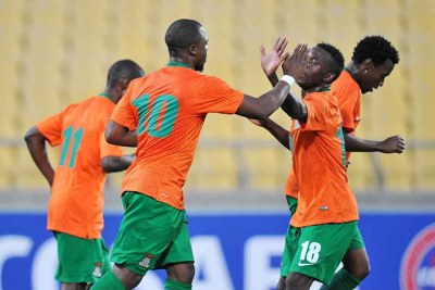 Zambian players celebrate win in Cosafa Cup semi-finals.
