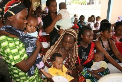 Women and their children visit a clinic at Sinza Health Centre in Tanzania's capital Dar es Salaam.