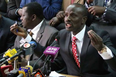 Kenya National Union of Teachers Secretary-General Wilson Sossion (right) during a press conference (file photo)