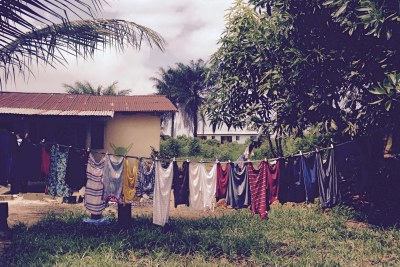 Home of 17-year-old Abraham Mamaigar, who died in a wave of Ebola cases in July 2015, showing the washing line with clothes of quarantined family members.