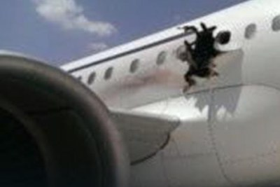 A hole caused by suspected bomb blast to the  A-321 jetliner.