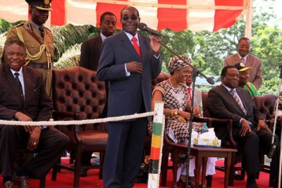 President Mugabe addresses Zanu-PF supporters ahead of a Politburo meeting at the party's headquarters in Harare.