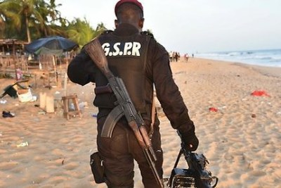 An Ivorian soldier at the Grand - Bassam beach after the attacks