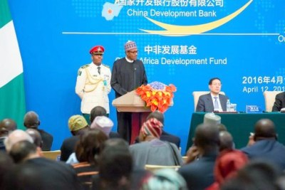 President Muhammadu Buhari speaking at the Official Opening Ceremony of the China-Nigeria Business Forum in Beijing, China (file photo).