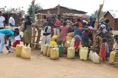 Residents waiting to draw water in Dar es Salaam (file photo).