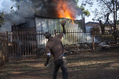 A shack on fire during protests in Tshwane.