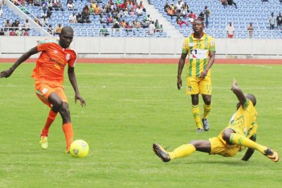 Zesco player takes on opponents (file photo).