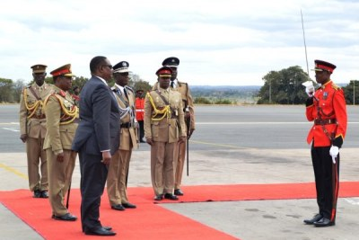 President Peter Mutharika inspects guard of honour (file photo).