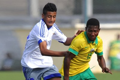 Amajimbos player fights for ball against Mauritius