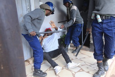 Police beat up protester in Harare this week.