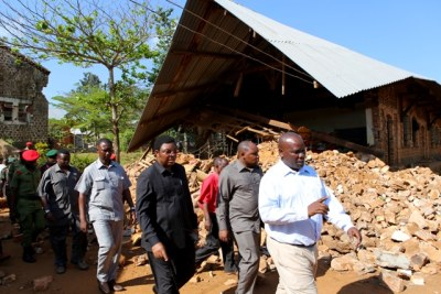 The Prime Minister, Mr Kassim Majaliwa, walks past Ihungo Secondary School, which was hit by the earthquake that occured in Bukoba Municipality Kagera Region.