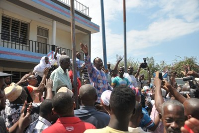 Fired Civic United Front (CUF) leader, Professor Ibrahim Lipumba, greets a section of party members.