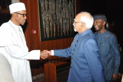 President Muhammadu Buhari receiving Indian Vice President Mohammad Ansari.