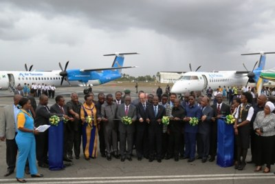 President John Magufuli cuts a ribbon to inaugurates the newly purchased two aircraft at Julius Nyerere International Airport .