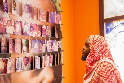 A visitor looks at photos of children killed during the 1994 Genocide against Tutsis at Kigali Memorial Centre in Gisozi (file photo)