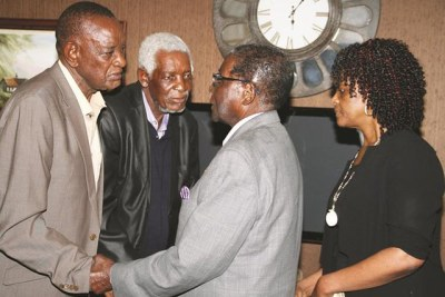 President Robert Mugabe and First Lady Grace Mugabe sympathize with Alec and Robert Msipa, brothers of the late Cephas Msipa.