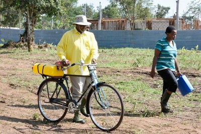 Museveni going to fetch water for irrigation.