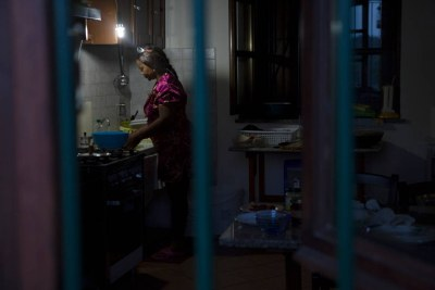 Princess, a Nigerian former sex slave trafficked into prostitution to pay off her 45,000 euro debt, washes dishes at her home in Italy, where she gained asylum after escaping her ordeal and set up a charity to help other victims.