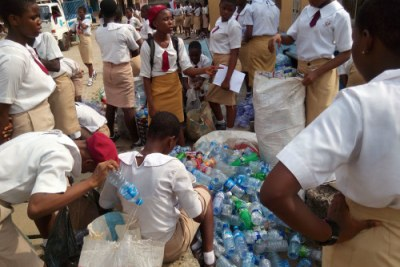 Students at the Wesley  Girls Senior Secondary School count up all the recyclables they collected as part of the