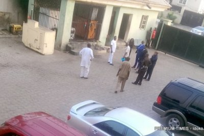 Police outside PREMIUM TIMES head office in Abuja during raid and arrest the newspaper's publisher and a reporter.