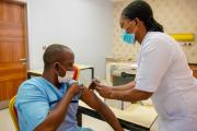 At Nizamiye Hospital, a private facility in Abuja, a nurse administers a second Covid-19 dose to a recipient.